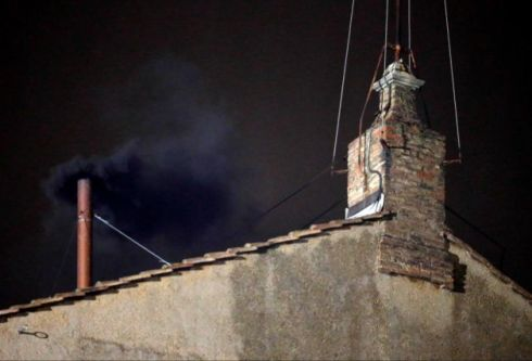 Black smoke billows from the chimney of the Sistine Chapel on March 12.