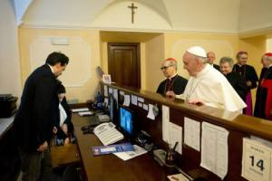 Pope Francis pays his hotel bill on the first day of his pontificate