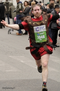 A Roman centurion (or reasonable facsimile) crosses the finish line during the 19th annual Rome marathon on March 17, 2013.
