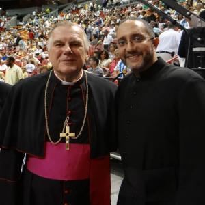 Seminarian Julio De Jesus poses with Miami Archbishop Thomas Wenski
