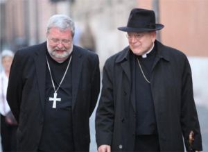 Bishop Daniel Jenky (left) strolls with Cardinal Raymond Burke