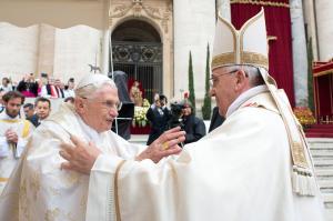 Pope Francis embraces Pope Emeritus Benedict