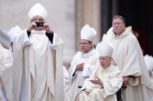 Bishops taking cell phone pics before the Mass