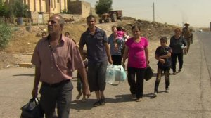 Christians flee Mosul earlier this summer